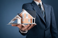 House. Real estate agent offer house represented by model stock photos