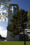 House. Tall modern glass house against the sky Stock Photo