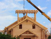 House. Wooden house under construction on a sky background royalty free stock images