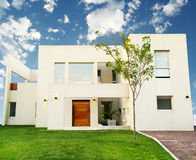House. A modern house with the sky on the background Royalty Free Stock Photo