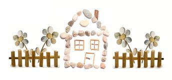 A house. With easy flower behind the fence made from little color pebbles Stock Photography