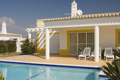 House. Beautiful villa with pool - typical architecture fom Algarve, south of Portugal Royalty Free Stock Images