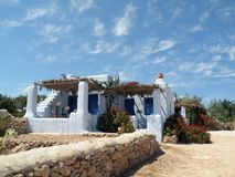 House. White bungalow front sea in greece island Royalty Free Stock Image