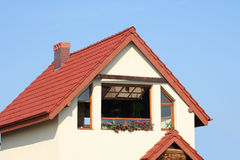 House. Top of house with blue sky background Stock Image