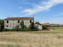 Casa Abbandonata. A house in abandonment on its field shrouded in mystery and curiosity Royalty Free Stock Image