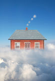 House above clouds Stock Photos