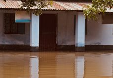 Flood water affected house unique photograph. A house affected by the flood water captured from a rural area in Bangladesh stock photo
