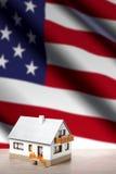 House against USA flag background Stock Photos