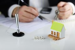 House Agents hands contract loan mortgage. House Agents hands a contract loan mortgage Stock Photos