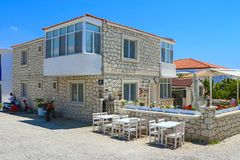 House in Alacati, Izmir, Turkey. Alacati, Izmir, Turkey - June 28, 2017: Street view in Alacati, Turkey. Alacati, well known for its architecture, vineyards and Stock Photo