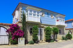 House in Alacati, Izmir, Turkey. Alacati, Izmir, Turkey - June 28, 2017: Street view in Alacati, Turkey. Alacati, well known for its architecture, vineyards and Royalty Free Stock Image