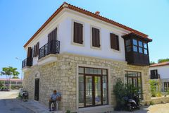 House in Alacati, Izmir, Turkey. Alacati, Izmir, Turkey - June 28, 2017: Street view in Alacati, Turkey. Alacati, well known for its architecture, vineyards and Royalty Free Stock Photo