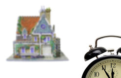 House with alarm-clock. Five to twelve Stock Images