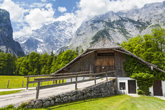 House in the Alps. Low building on the background of mountains Royalty Free Stock Photos