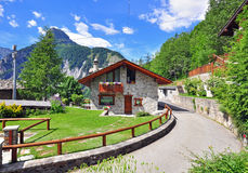 House in Alps Stock Images
