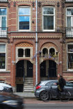 House in Amsterdam and cycler royalty free stock photos