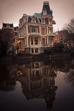 House in Amsterdam. Next to canal. Like in mirror Royalty Free Stock Image