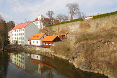 House And Castle Above A River Stock Photo