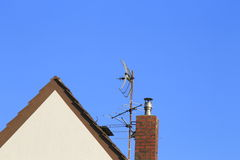 House with antenna and chimney Royalty Free Stock Photo
