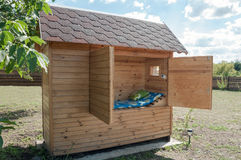 House for apiotherapy. Wooden single-seat house for apiotherapy outdoor at summer sunny day Royalty Free Stock Image
