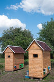 House for apitherapy. Wooden single-seat house for apiotherapy outdoor at summer sunny day Royalty Free Stock Image