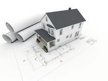 House on architectural drawing with rolled pages Royalty Free Stock Photography