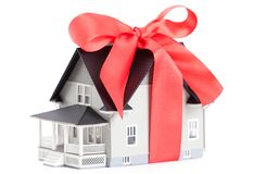 House architectural model with red bow Royalty Free Stock Images
