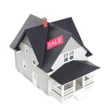 House architectural model with sale sign, isolated Stock Image