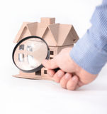 House architectural model under magnifying glass. Real estate concept - house architectural model under magnifying glass stock images