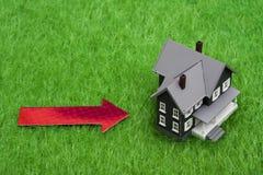 House with arrow Stock Photos