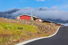 House and Asphalt Road in East Iceland Stock Photography