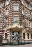 House with atlantes statue in historical area of Odessa Royalty Free Stock Photos