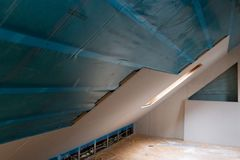 House attic insulation and renovation. Drywall construction. In natural light stock image