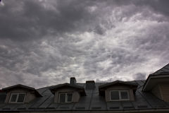 House attic with storm clouds. House attic and storm clouds Royalty Free Stock Photo