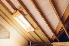 House attic under construction mansard insulation. House attic under construction mansard wall insulation with rock wool Royalty Free Stock Photo