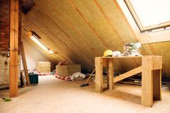 House attic under construction mansard wall insulation. With rock wool Stock Photography