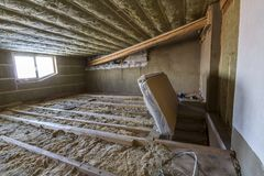 House attic under construction. Mansard walls and ceiling insulation with rock wool. Fiberglass insulation material in wooden fram. E for cold barrier royalty free stock images