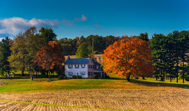 House and autumn colors in rural York County, Pennsylvania. Stock Photos