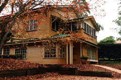 House in Autumn. A photo of an old house with colorful autumn leaves. Mount Tamborine, QLD, Australia Royalty Free Stock Image