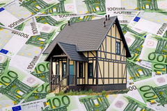 House on the background of the banknotes of 100 euros Royalty Free Stock Photography