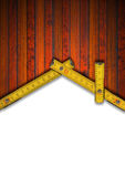 House Background - Wood Meter Tool. Wood Background and wooden yellow meter tool forming a house on white background royalty free illustration