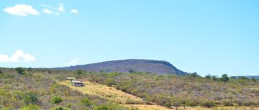 House in the backlands of Bahia in Brazil with mountains and local vegetation. Of the sertão stock photos