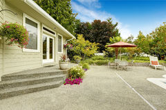 House  backyard with patio table. Real estate in Federal Way,. Backyard with flower pots and patio table set with umbrella. Real estate in Federal Way, WA Stock Images