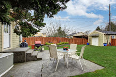 House backyard with small patio area Royalty Free Stock Image