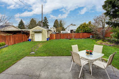 House backyard with small patio area Stock Photos