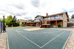 House backyard with sport court and patio area Royalty Free Stock Photography