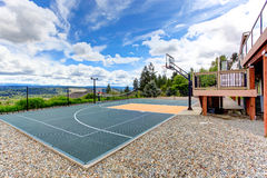 House backyard with sport court Stock Photo