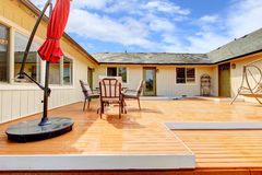 House backyard. Walkout deck with patio area Royalty Free Stock Images