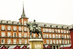 Equestrian statue of Felipe III House of the Bakery in the background in . Madrid royalty free stock photo