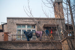 House and balcony with hanged clothes Royalty Free Stock Photos